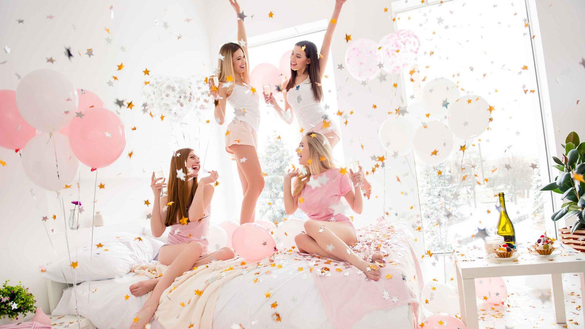 Four-women-celebrating-on-bed