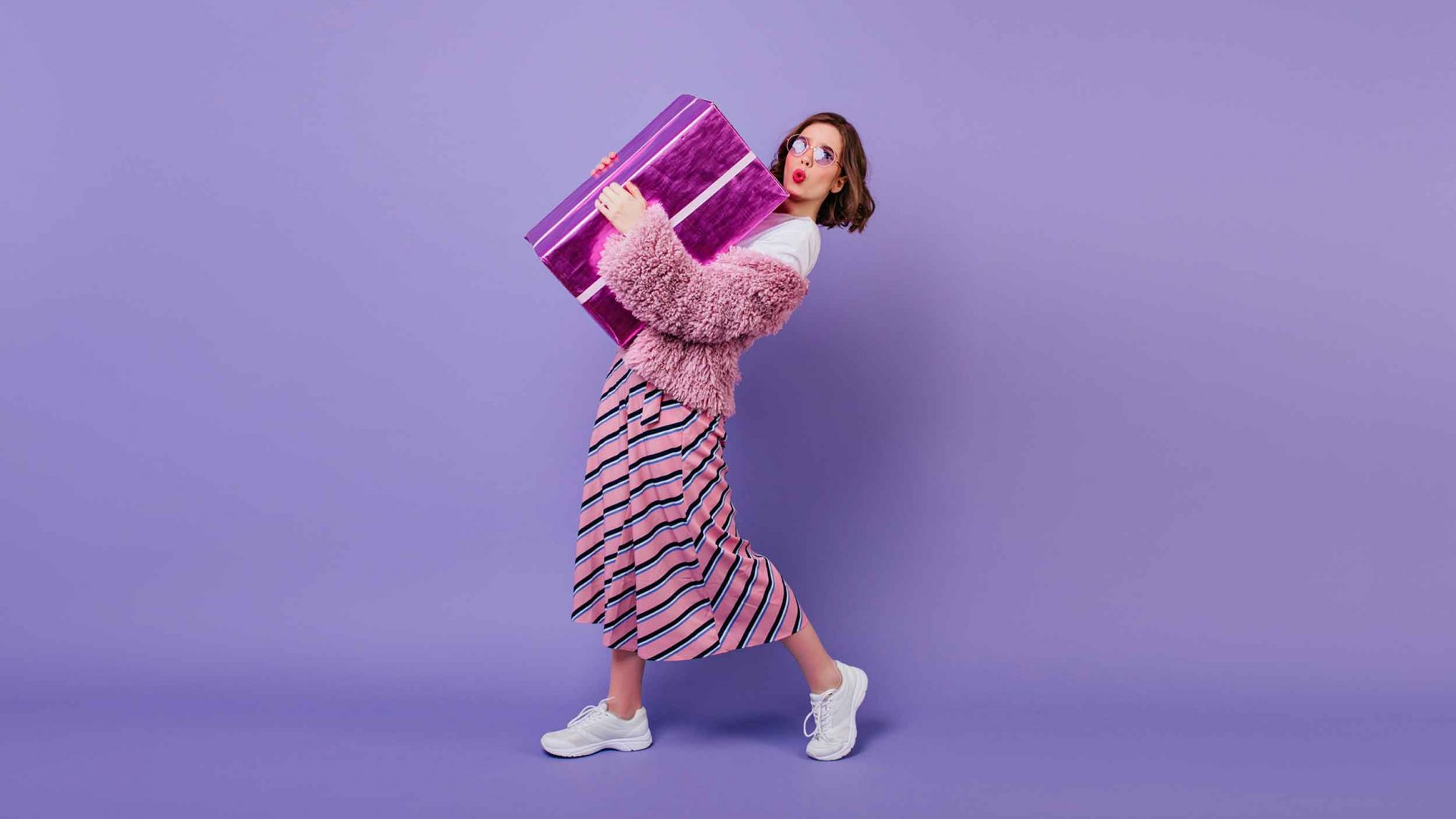 Purple-BG-woman-holding-gift